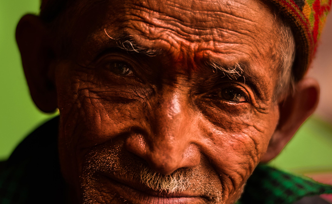 Older man with weathered skin
