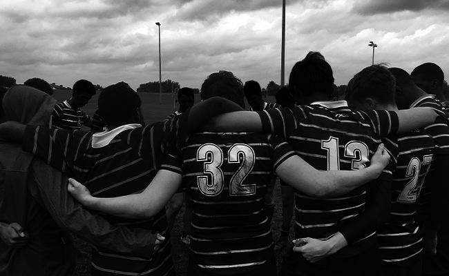A rugby team huddle