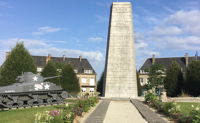 A WW2 tank monument on a roundabout in France