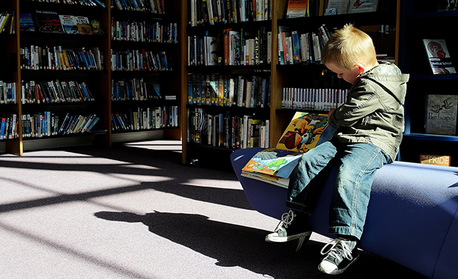 A young boy reading